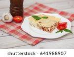 portion of tasty lasagna on... | Shutterstock . vector #641988907