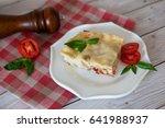 portion of tasty lasagna on... | Shutterstock . vector #641988937
