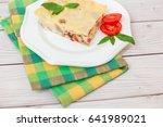 portion of tasty lasagna on... | Shutterstock . vector #641989021