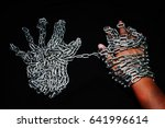 hand with chain chain in hand... | Shutterstock . vector #641996614