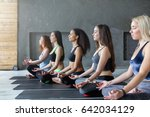 young women in yoga class ... | Shutterstock . vector #642034129