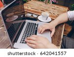 a young bank employee busy on a ... | Shutterstock . vector #642041557