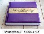 wedding book in purple wrapper... | Shutterstock . vector #642081715