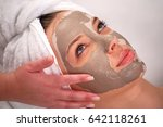 spa clay mask on a woman's face ...   Shutterstock . vector #642118261