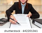 businesswoman pointing a place... | Shutterstock . vector #642201361