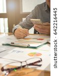 business man holding smartphone ...   Shutterstock . vector #642216445