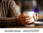 woman hand holding the cup of... | Shutterstock . vector #642252055
