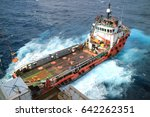 supply boat transfer cargo to... | Shutterstock . vector #642262351