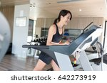 woman training on treadmill | Shutterstock . vector #642273919