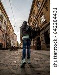 woman walking by old europian... | Shutterstock . vector #642284431