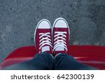 a pair of red canvas sneakers... | Shutterstock . vector #642300139
