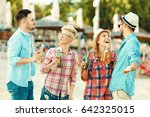 group of friends enjoying... | Shutterstock . vector #642325015