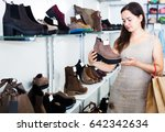 smiling young brunette buying... | Shutterstock . vector #642342634