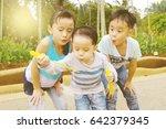 asian kids blowing bubbles... | Shutterstock . vector #642379345