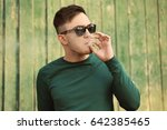 handsome young man smoking weed ... | Shutterstock . vector #642385465