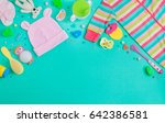 Stock photo baby accessories background baby jumpsuit socks soother and toys over green background with copy 642386581