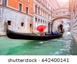 woman with a red umbrella in... | Shutterstock . vector #642400141