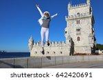 young woman joyfully jumping in ... | Shutterstock . vector #642420691