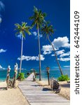 tropical beach scene with... | Shutterstock . vector #642444109