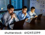 business people working late at ... | Shutterstock . vector #642451099