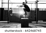 fit young man jumping onto a... | Shutterstock . vector #642468745