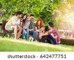 group of young people having... | Shutterstock . vector #642477751