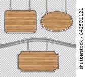 empty wooden hanging signs... | Shutterstock . vector #642501121