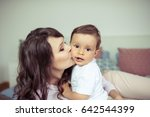 young mom and young son sitting ... | Shutterstock . vector #642544399