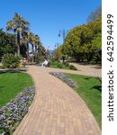 Walking avenue with palm trees and flower beds, resort Sochi, Russia - stock photo