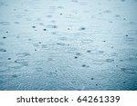 Rain Drops Rippling In A Puddl...