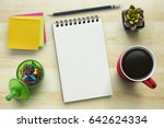notebook on office table with a ... | Shutterstock . vector #642624334
