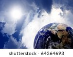 Planet earth in space with sun and clouds - stock photo