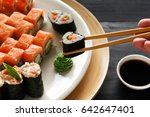 eating roll sushi in japanese... | Shutterstock . vector #642647401
