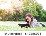 beautiful woman reading a book... | Shutterstock . vector #642656035