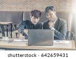 two attractive businessmen... | Shutterstock . vector #642659431