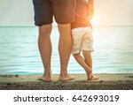 father and son stay on the sea... | Shutterstock . vector #642693019