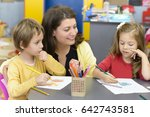 kids drawing at kindergarten... | Shutterstock . vector #642743581