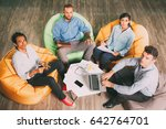 four business people sitting on ... | Shutterstock . vector #642764701