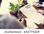 hands holding wedding planner...   Shutterstock . vector #642775639