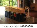 plain light wooden coffin in a... | Shutterstock . vector #642806584
