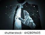 business man touching world map ... | Shutterstock . vector #642809605