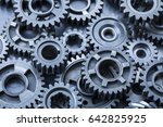 a large pile of steel gears on... | Shutterstock . vector #642825925