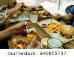 view of hands of people eating...   Shutterstock . vector #642853717