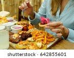 view of hands of people eating...   Shutterstock . vector #642855601