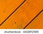brightly lacquered boards of... | Shutterstock . vector #642892585
