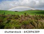 A Full Rainbow Over A Green...