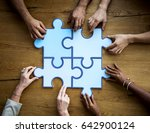 group of people holding puzzle... | Shutterstock . vector #642900124