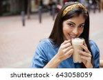 portrait of smiling beautiful... | Shutterstock . vector #643058059