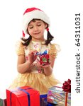 Smiling little girl with Christmas gift box - stock photo