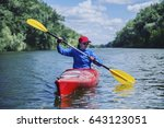 a girl rafts down the river on... | Shutterstock . vector #643123051